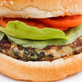 Turkey burger with lettuce and tomato on a bun