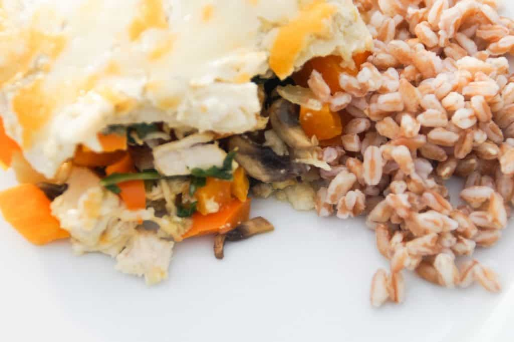 One serving of enchilada bake with farro on a white plate