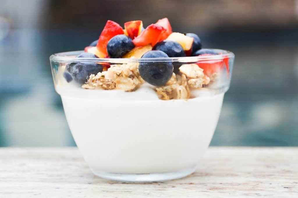 yogurt, granola, and fruit, layered