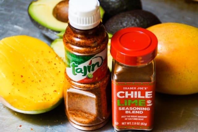 Tajin next to a jar of Trader Joe's chili lime seasoning