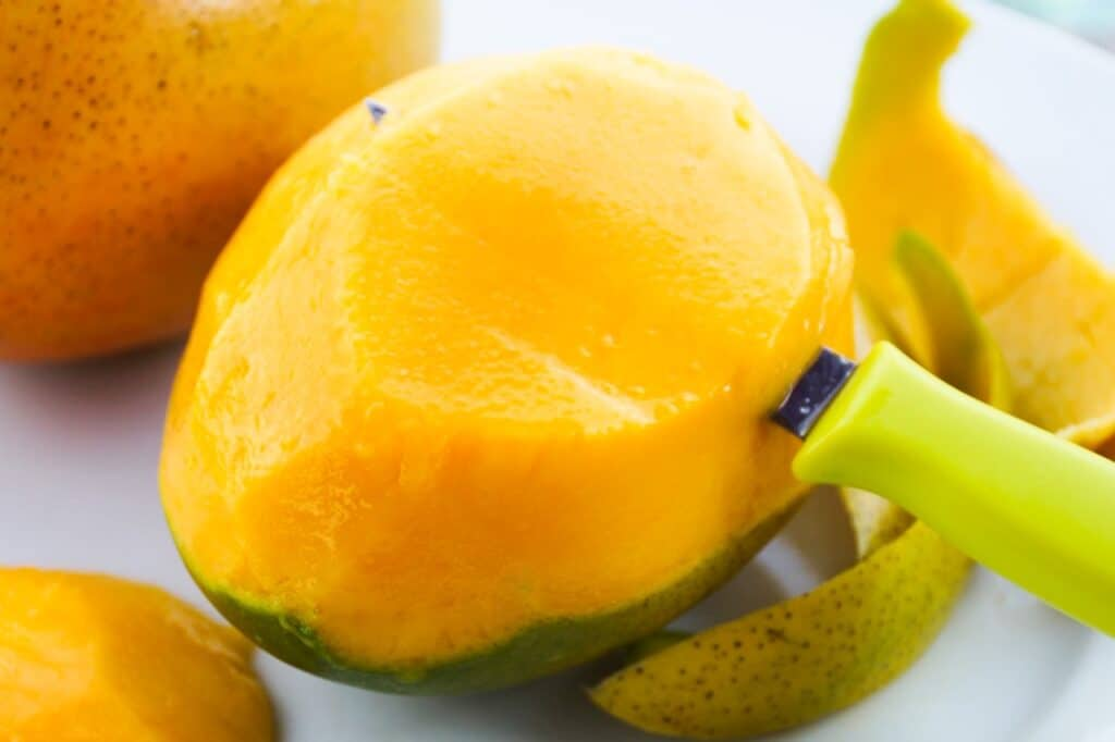 Mango being sliced
