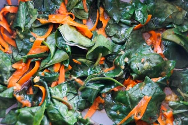 Spinach and carrot ribbons, cooked in a skillet