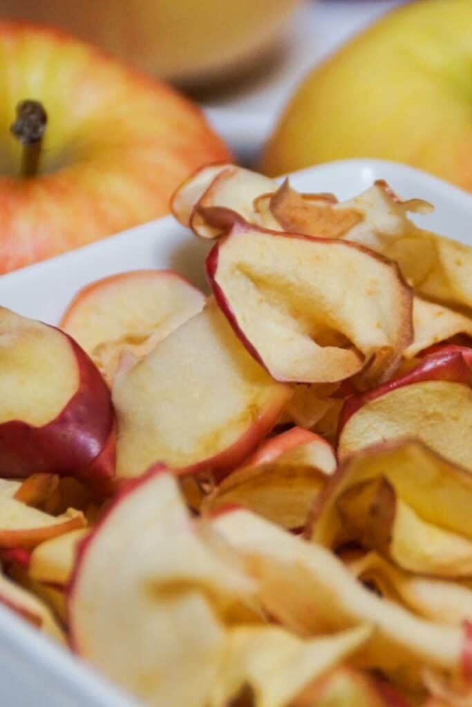 air fried apple slices in a white serving dish