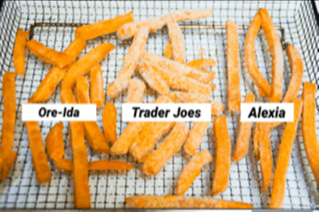 three brands of frozen sweet potato fries in a single layer on a air fryer basket