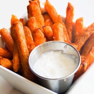 sweet potato fries with yogurt dip in a white square dish