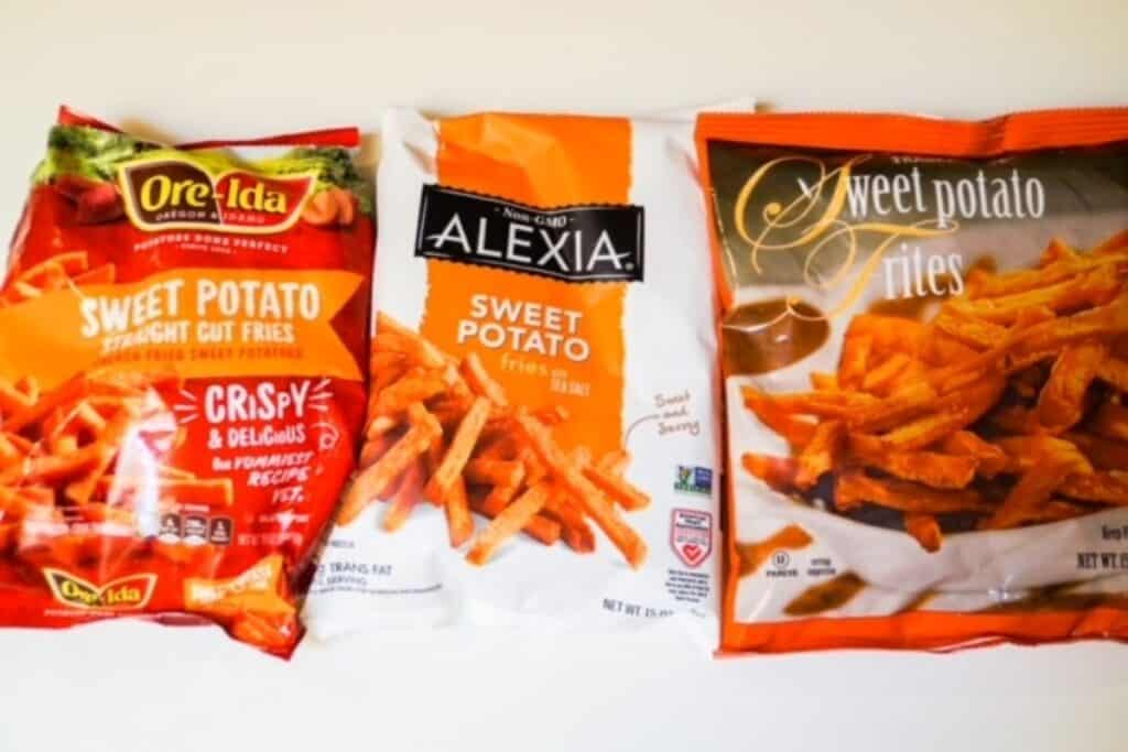 three bags of sweet potato fries next to eachother: Ore-Ida, Trader Joe's, and Alexia