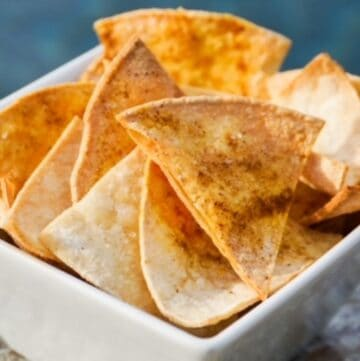 air fried tortilla chips in a white square bowl