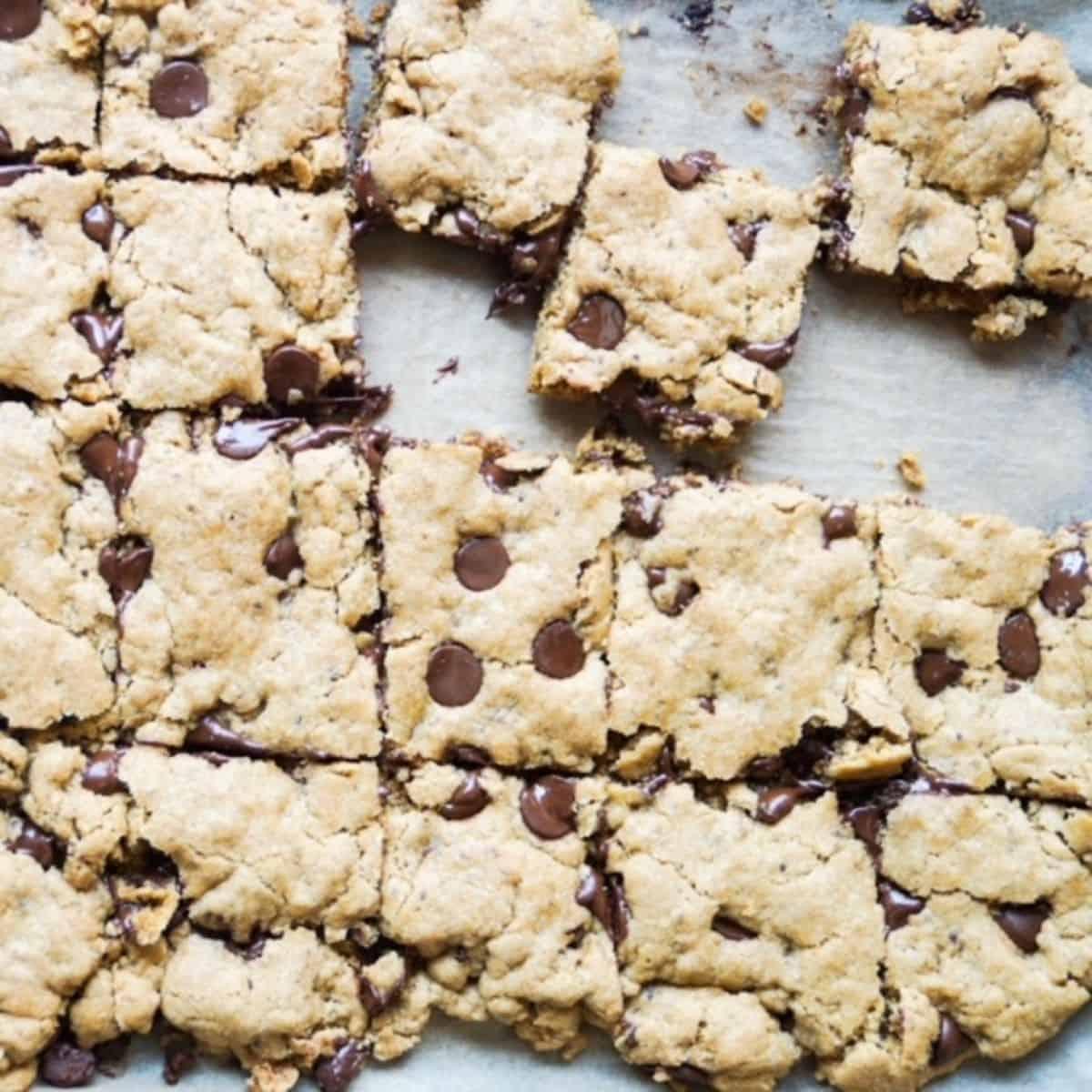 vegan blondie squares on a baking sheet