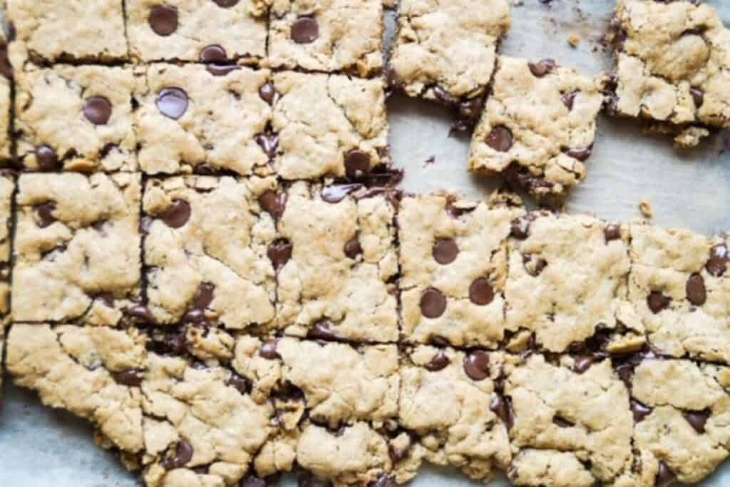 vegan blondies cut in squares while still on the pan.