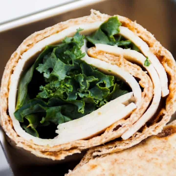 healthy chicken wrap, halved, with the inside showing